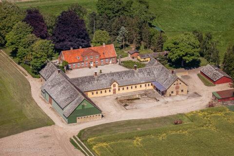 Luftfoto af landejendomme